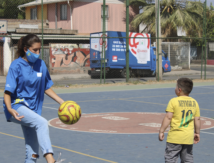 Photo of a missionary playing ball with a boy